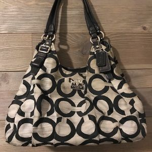 Medium/large Coach purse with three compartments.